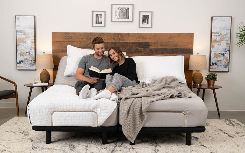 Man and woman reading on their Podium adjustable bed