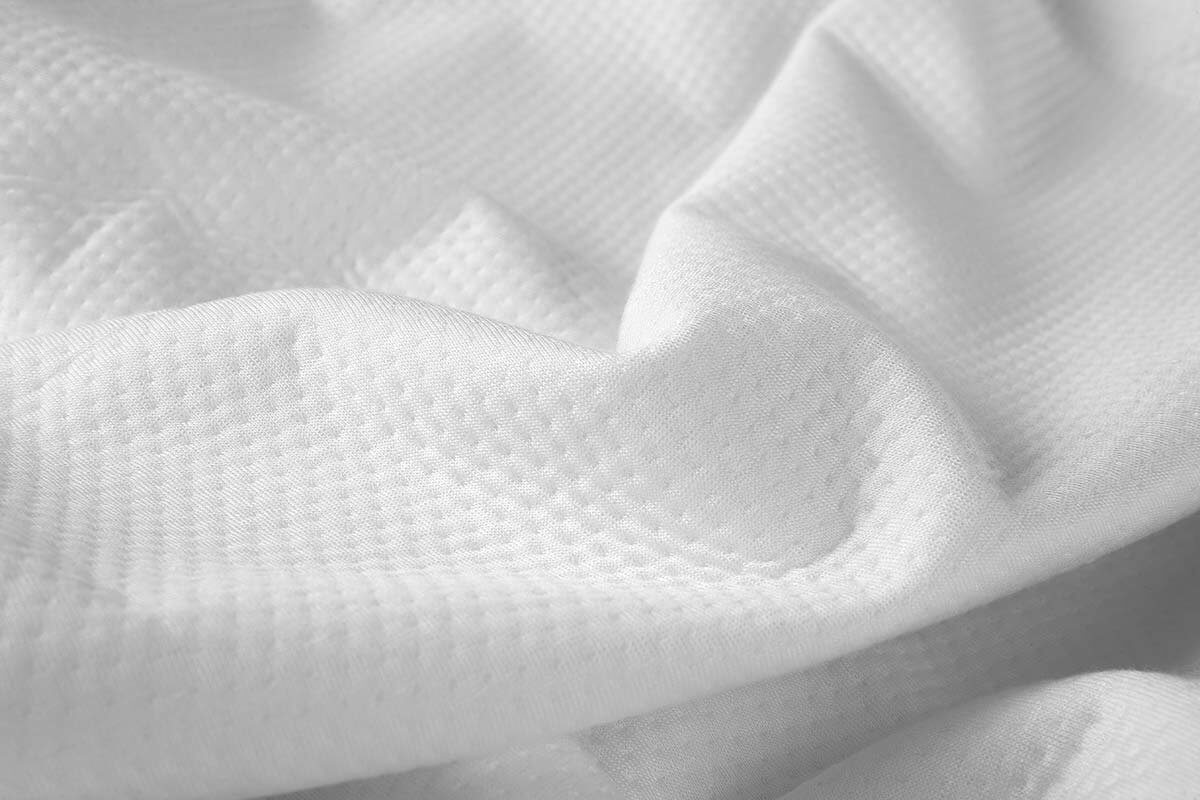 A close view of the mattress protector's fabric