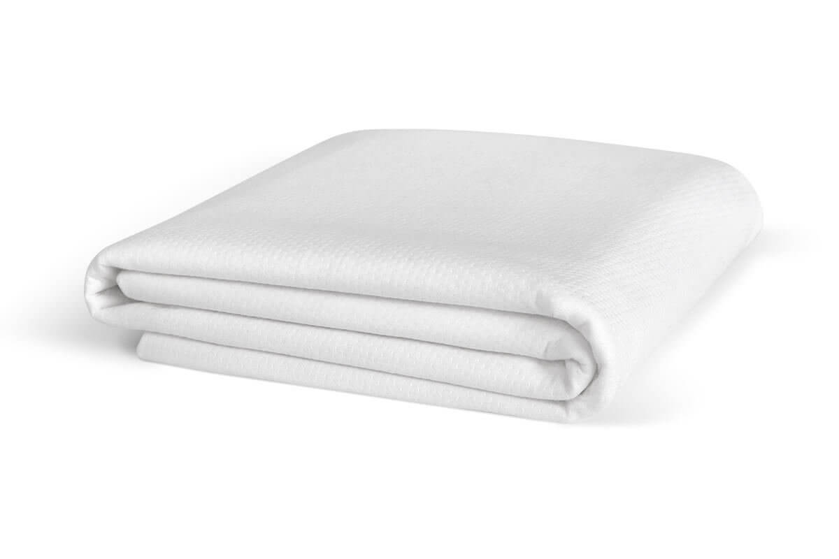 Folded mattress protector against a white background